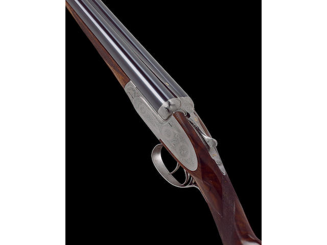 A 12-bore self-opening rounded bar sidelock ejector gun by J. Purdey, no. 25717 In its brass-mounted oak and leather case