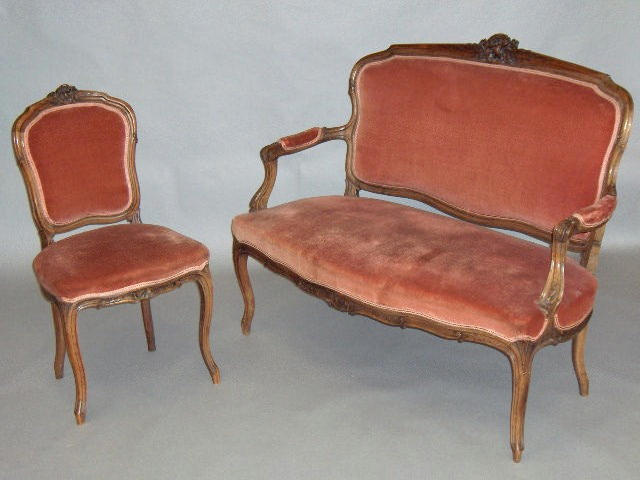 A Louis XV style carved walnut salon suite,
