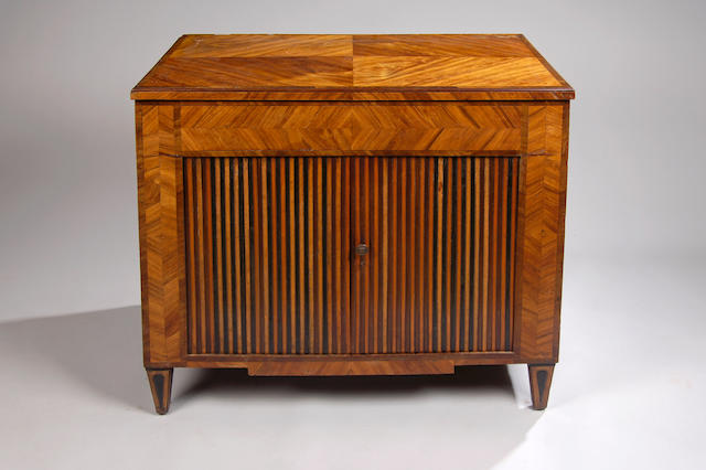 An early 19th Century French kingwood and tulipwood banded peudreuse,