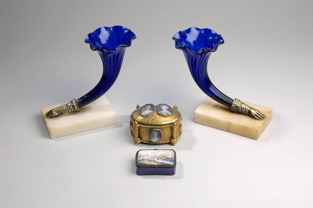 A pair of mid 19th Century blue glass cornucopia vases,
