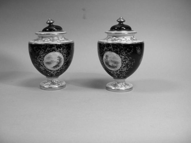 A pair of Coalport porcelain vases and covers,