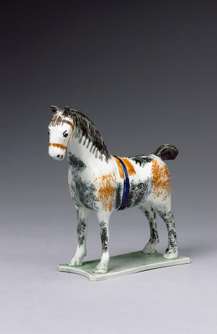 A pearlware model of a horse circa 1800