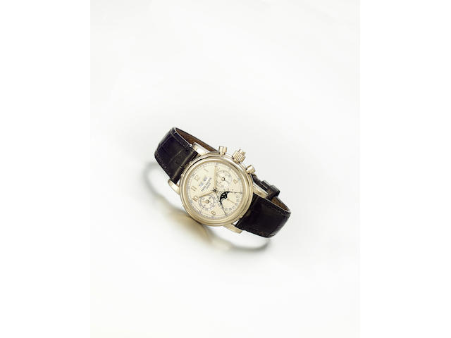 Patek Philippe. A fine and rare 18ct white gold wristwatch with perpetual calendar, moon phase and split-second chronograph Ref:5004, No.879829, Sold 27th April 2001