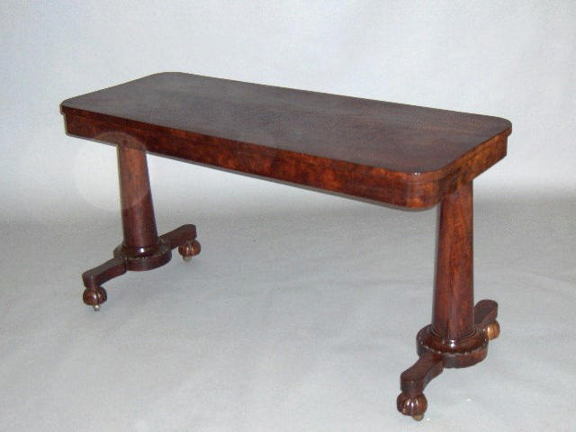 An Early Victorian mahogany crossbanded centre table,