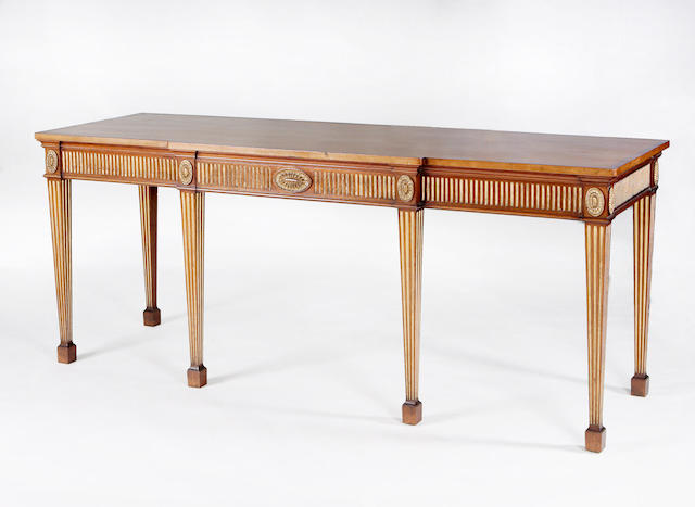 A George III style mahogany and gilt detailed breakfront serving table stamped Morison & Co. of Edinburgh