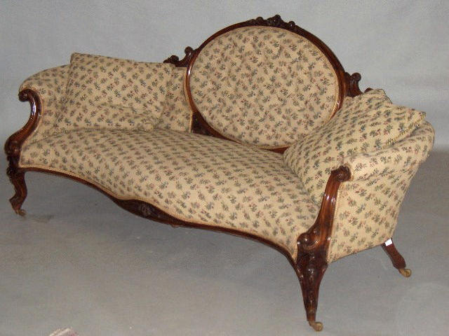 A matched suite of Victorian carved walnut salon furniture,