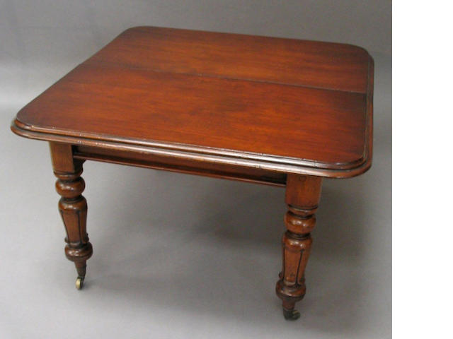An early/mid-Victorian mahogany extending dining table