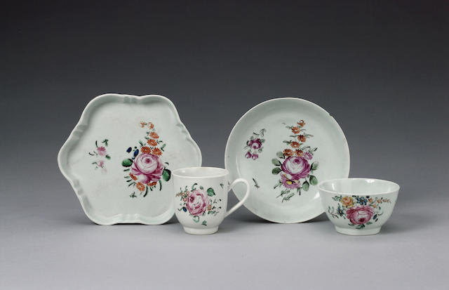 A Chaffers teabowl, coffee cup and saucer and a teapot stand circa 1758-60