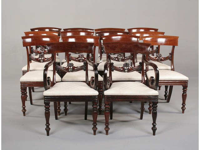 A set of fourteen William IV style mahogany dining chairs