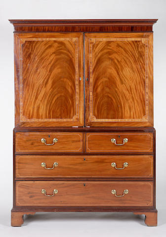 A George III mahogany and cross-banded linen press
