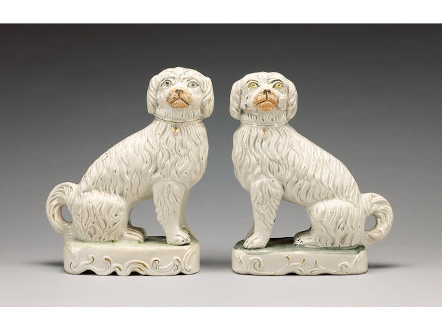 A pair of pipe smoking spaniels, circa 1850,