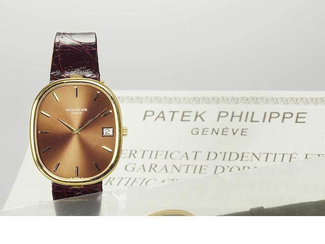 Patek Philippe. A fine 18ct gold automatic calendar wristwatch together with certificate and box   Ellipse, No.1305427, Ref:3605, Produced in the 1970s, Sold 5th of October 1988
