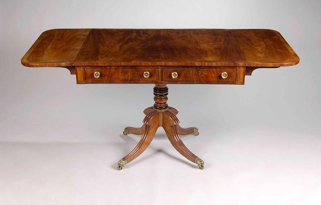 A Late Regency mahogany and rosewood crossbanded sofa table,
