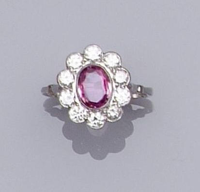 A pink sapphire and diamond oval cluster ring