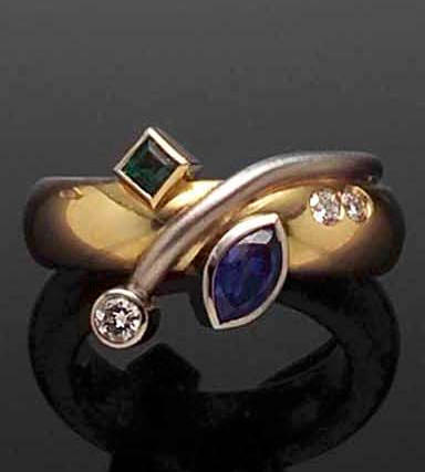 A sapphire, emerald and diamond ring