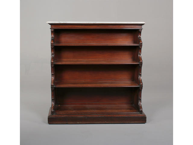 A 19th century mahogany and marble topped waterfall open bookcase