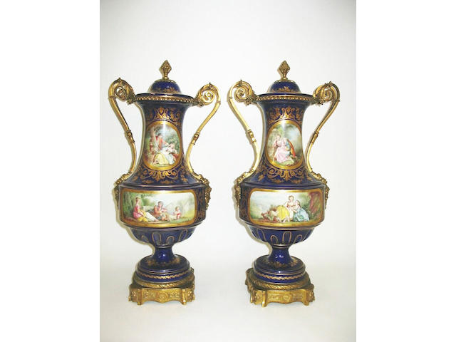 A pair of Sevres style vases and covers