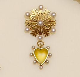 A late Victorian seed pearl and rock crystal heart shaped pendant, (2)