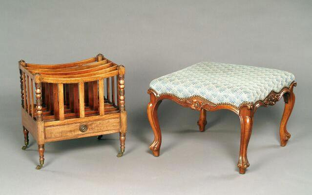 An early 19th century mahogany canterbury,