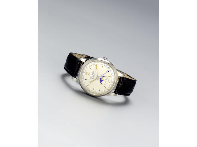 Rolex. A very fine and rare stainless steel automatic triple calendar wristwatch with phases of the