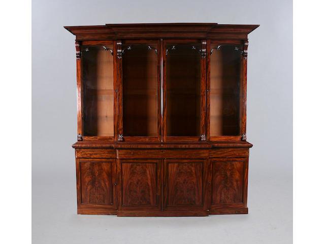 An early Victorian mahogany breakfront bookcase