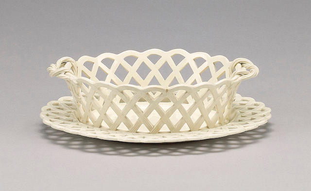 A creamware pierced basket and stand, circa 1800,