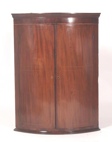 A Regency mahogany wall mounted corner cabinet