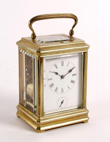 A brass cased carriage clock with an alarm and repeating mechanism