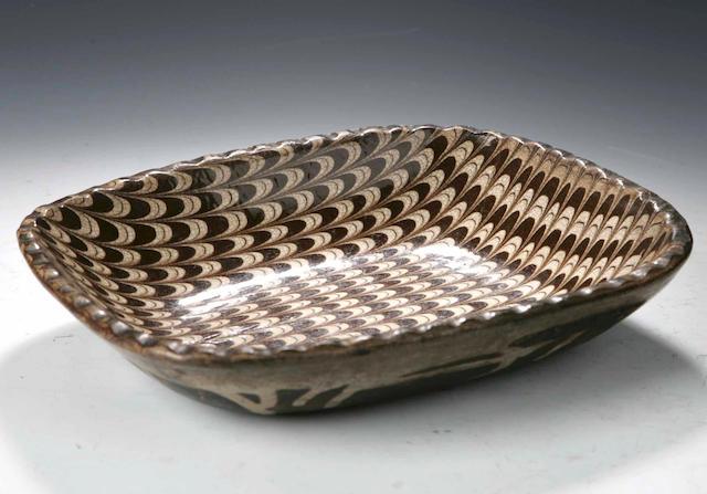 A Staffordshire slipware dish, 19th century,