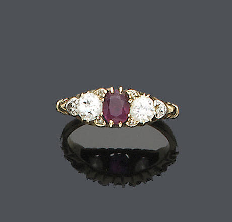 A late Victorian ruby and diamond three-stone ring,