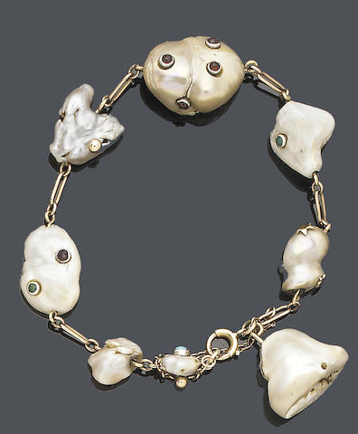 An early 20th century baroque pearl and gem-set bracelet