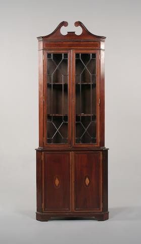 A George III style mahogany corner cabinet