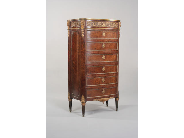 A Louis XVI style plum pudding mahogany and gilt metal mounted semainier