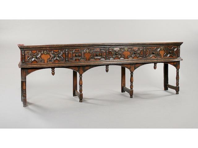 A late 17th Century oak low dresser