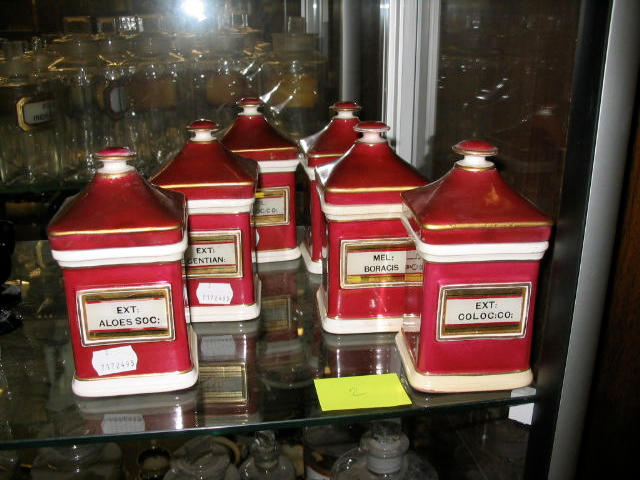 Six earthenware ointment jars and covers,