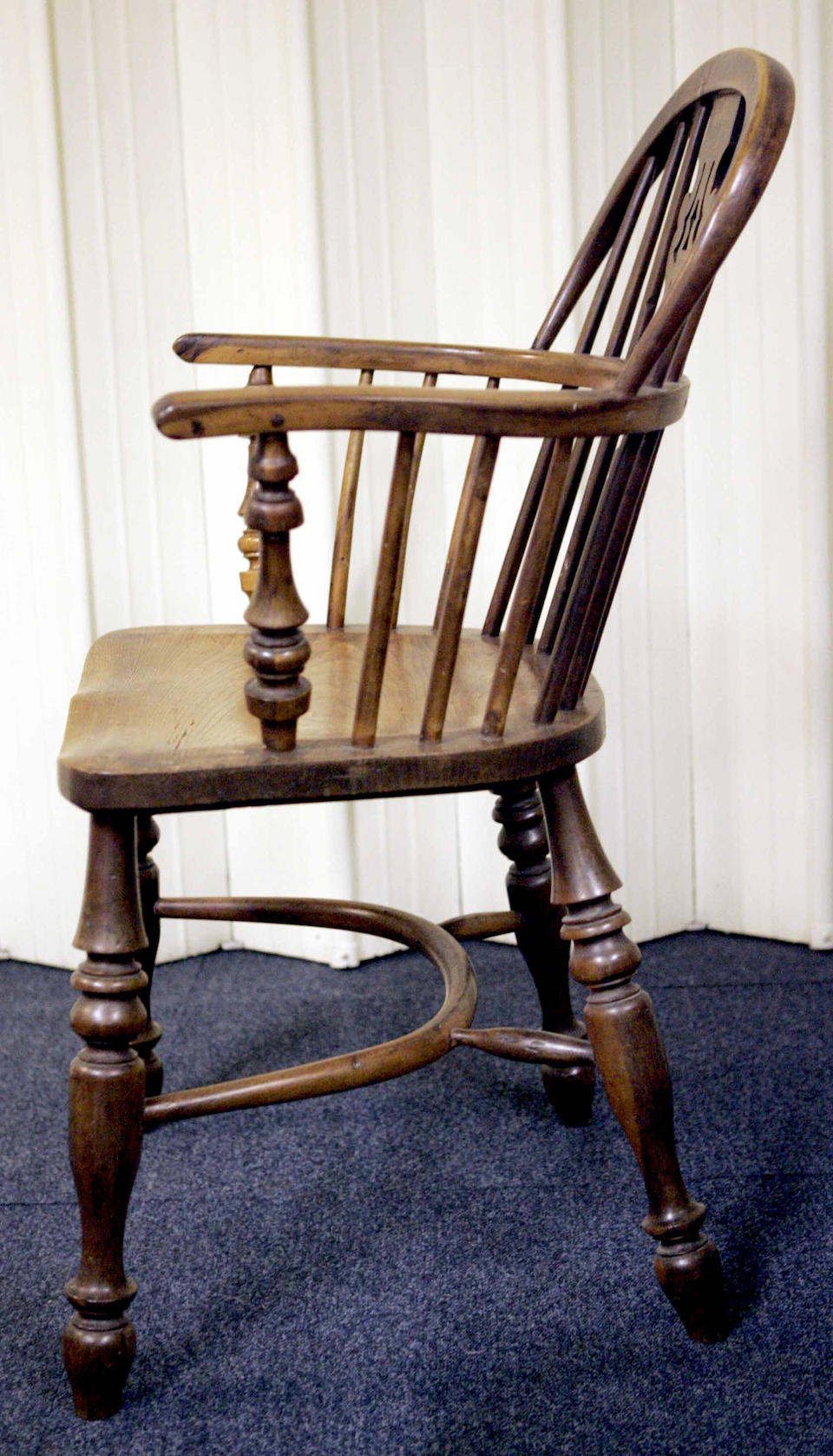 A matched pair of mid 19th century ash elm and yew wood windsor armchairs