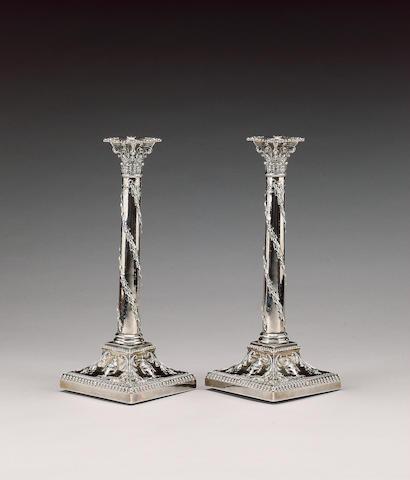 An Edwardian pair of silver candlesticks, by T. Bradbury, London 1904,