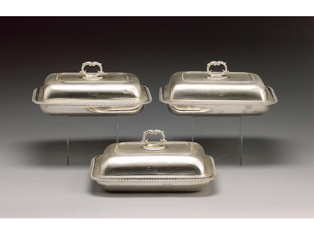 A George III set of three silver entrée dishes and covers, by Robert Garrard, London 1811,