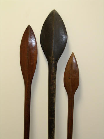 Three Solomon Island paddle clubs, a Fiji ula and New Caledonian figure 5