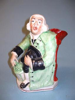 A William Kent model of a Night Watchman jug circa 1900,