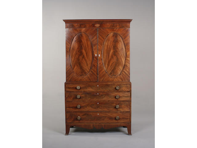 A Regency flame mahogany linen press