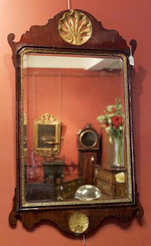 A George III mahogany and giltwood wall mirror
