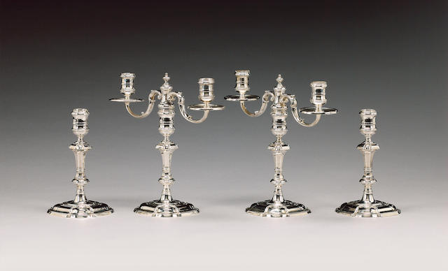 A modern silver pair of candelabra and a pair of candlesticks ensuite, by C. J. Vander, London 1970,
