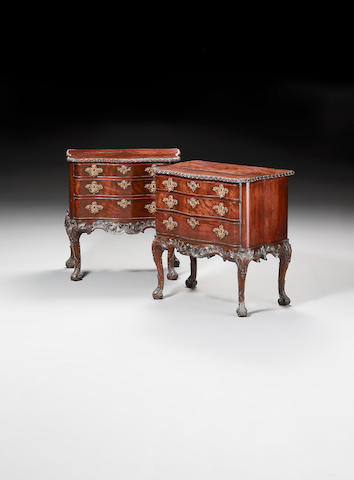 A pair of George II carved mahogany serpentine Commodes,possibly attributable to Thomas Chippendale