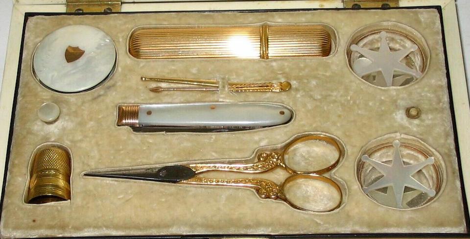 An early 19th century tortoiseshell sewing box