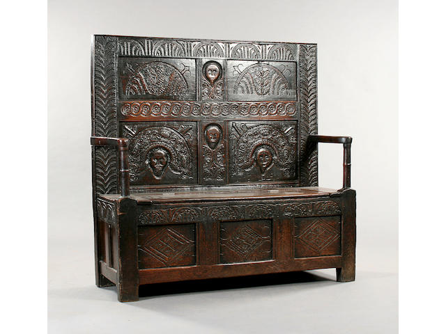 A 17th Century carved oak box settle