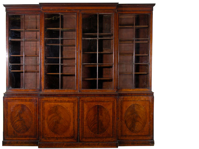 A George III mahogany and satinwood breakfront library bookcase