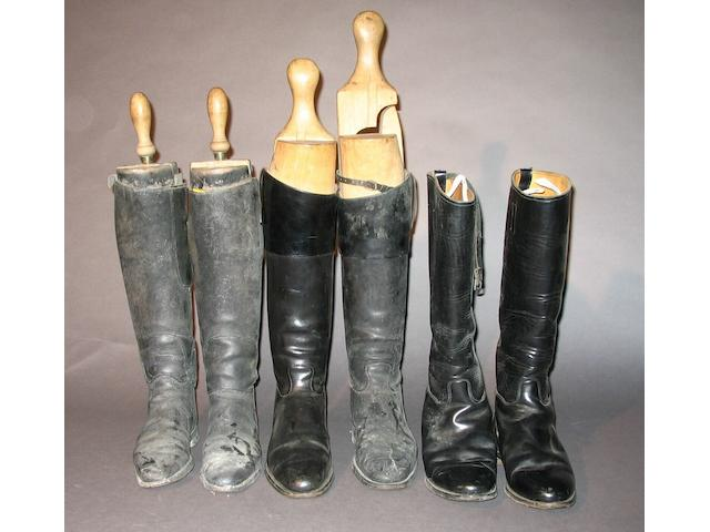 Two pairs of black leather riding boots,