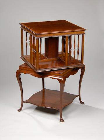 An Edwardian mahogany and satinwood cross banded revolving bookcase