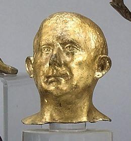 A gilt metal bust of a man